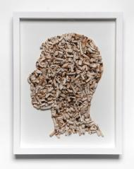 Joao Leonardo | Untitled (Self portrait in profile 2) 2010 beatas de cigarros encontradas sobre tela, moldura de madeira e vidro 42x30cm