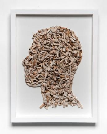 Joao Leonardo | Untitled (Self portrait in profile 2) 2010 beatas de cigarros encontradas sobre tela, moldura de madeira e vidro 42x30cm